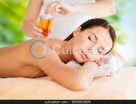 close up of beautiful woman having massage at spa stock photo, wellness, spa and beauty concept - close up of beautiful woman having massage over green natural background by Syda Productions