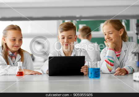 kids with tablet pc at school laboratory stock photo, education, science and technology concept - kids with tablet pc computer studying chemistry at school laboratory by Syda Productions