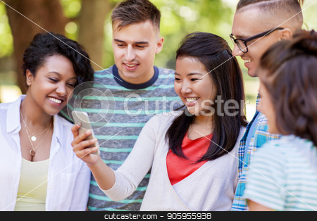 group of happy friends with smartphone outdoors stock photo, friendship, technology and international concept - group of happy smiling with smartphone outdoors by Syda Productions