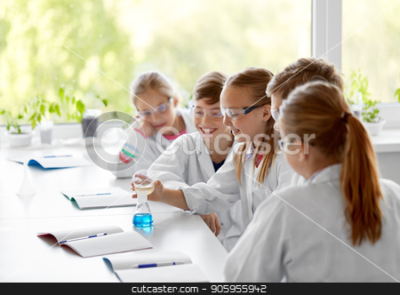 kids with test tube studying chemistry at school stock photo, education, science, chemistry and children concept - kids or students with test tube making experiment at school laboratory by Syda Productions
