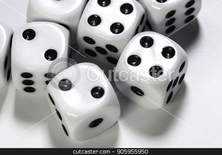 Macro shot of dice on white background stock photo, Macro shot of multiple dice on white background by Shane Maritch