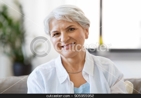 portrait of happy senior woman laughing stock photo, emotion, age and people concept - portrait of happy senior woman laughing by Syda Productions