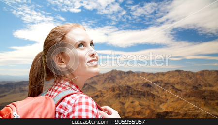 smiling woman with backpack over grand canyon stock photo, adventure, travel, tourism, hike and people concept - smiling young woman with backpack over grand canyon national park hills background by Syda Productions