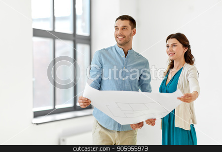 happy couple with blueprint at to new home stock photo, mortgage, people and real estate concept - happy couple with blueprint at to new home by Syda Productions