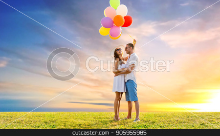 happy couple with balloons over sunset sky stock photo, love, summer, dating and birthday concept - happy couple wearing sunglasses with balloons hugging on meadow over sunset sky background by Syda Productions