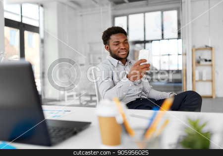 businessman with smartphone at office stock photo, business, people and technology concept - african american businessman with smartphone at office by Syda Productions