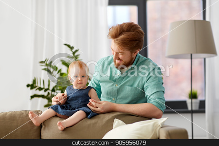 happy father with little baby daughter at home stock photo, family, fatherhood and people concept - happy red haired father with little baby daughter at home by Syda Productions