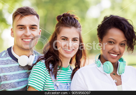 group of happy smiling friends with headphones stock photo, people, friendship and international concept - group of happy smiling friends with headphones outdoors by Syda Productions
