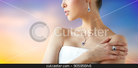 beautiful woman with earring, ring and pendant stock photo, beauty, jewelry, people and luxury concept - beautiful asian woman or bride with earring, finger ring and pendant over pastel background by Syda Productions