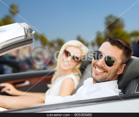 happy couple driving in convertible car stock photo, road trip, travel and people concept - happy couple driving in convertible car over venice beach background in california by Syda Productions