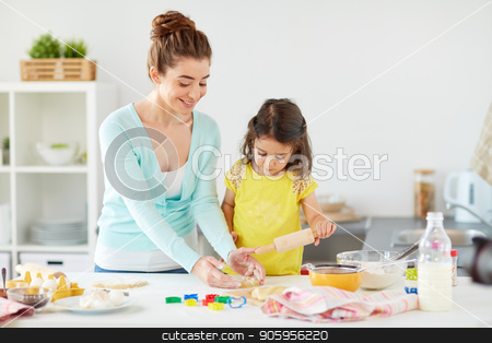 happy mother and daughter making cookies at home stock photo, family, cooking and people concept - happy mother and little daughter with rolling pin making cookies from dough at home kitchen by Syda Productions