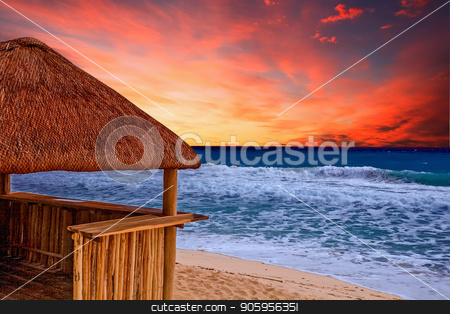 Beach Hut and Stormy Sea stock photo, A bamboo and thatched straw hut providing shelter from a stormy sea and sky by Darryl Brooks