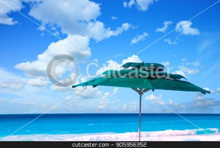 Green Umbrella and Ocean stock photo, A green sun umbrella against a blue sky and ocean by Darryl Brooks