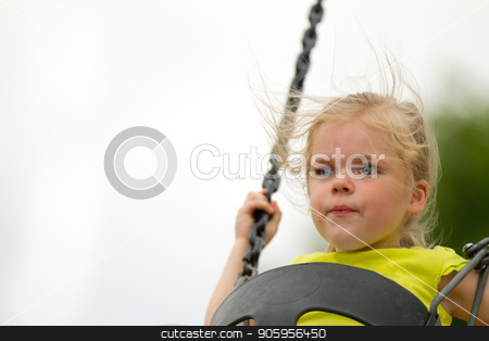 Having fun on the swings stock photo, Young female child having fun at a playground on the swings. Copy space available on the left by txking