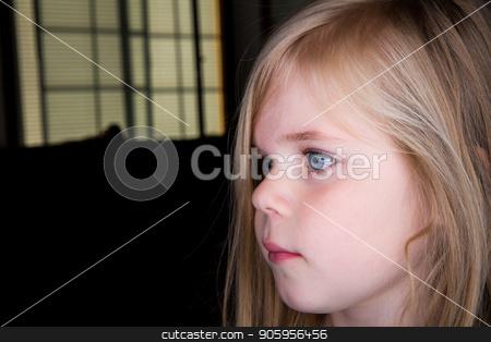 Sad little girl stock photo, Sad girl in the dark  by txking