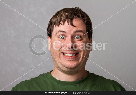 guy making a weird smile stock photo, He likes to smile at the camera  by txking