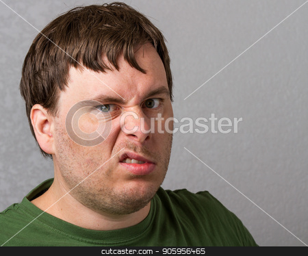 Unhappy guy  stock photo, Man making a unhappy face at the camera by txking