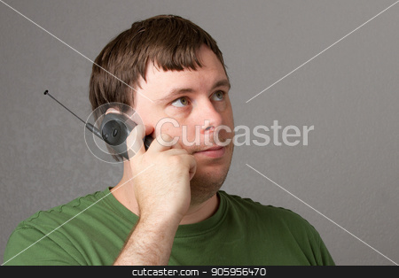 man waiting on his phone. stock photo, man waiting for someone to answer the phone by txking