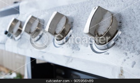 knobs covered in snow stock photo, Winter comes and no more outdoor grilling season is left. by txking