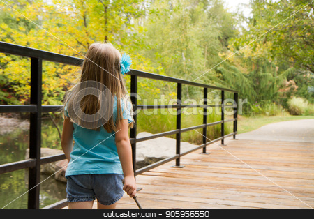 Walking down a path stock photo, Little girl on a wooden bridge in the woods walking down her path of exploration by txking