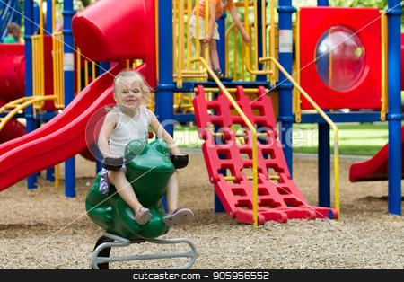 Smiling kid on the playground stock photo, Child having fun and smiling at the playground by txking