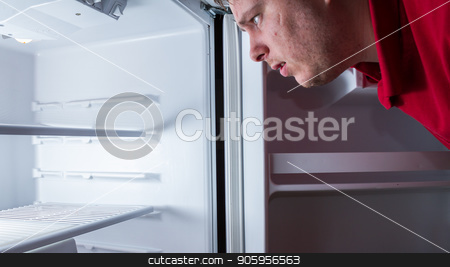 Where is my food stock photo, White male looking into his fridge to find food only to find there is none. by txking