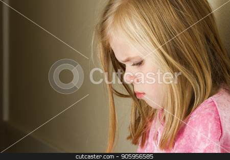 child against the wall with a sad look stock photo, Child could be sad due to abuse, domestic violence, or even sad due to a bully by txking