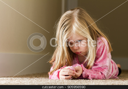 Child laying in the hallway sad stock photo, Child could be sad due to abuse, domestic violence, or even sad due to a bully by txking