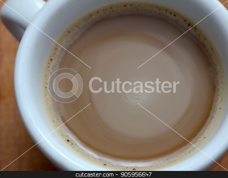 Instant coffee in a cup. Foam coffee. stock photo, Instant coffee in a cup. Foam coffee. Coffee rotation in a cup by Oleksii Tim