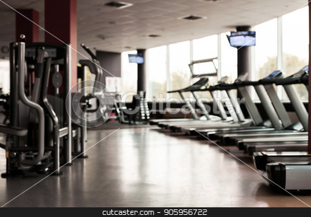 Gym interior with equipment stock photo, Gym interior with equipment. light modern room with row of treadmills and fitness stations. concept of sport and healthy lifestyle by Oleh