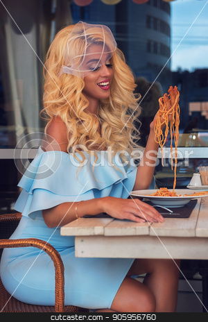 Pasta in the cafe stock photo, Food, people and leisure creative concept - beauty blonde young woman eating pasta in cafe by olinchuk