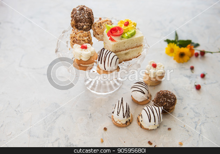 Different cakes composition stock photo, Different cakes composition on concrete background by olinchuk