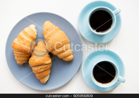 cup of coffee with croissant stock photo, cup of coffee with croissant on white background by Sergiy Artsaba