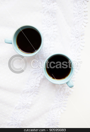 cup of coffee with croissant stock photo, two cups of coffee with croissants on the background of laces on a white background, close-up by Sergiy Artsaba
