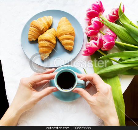 Girl with croissants and coffee, a bouquet of pink tulips, happy morning stock photo, Girl with croissants and coffee, a bouquet of pink tulips, happy morning. by Sergiy Artsaba