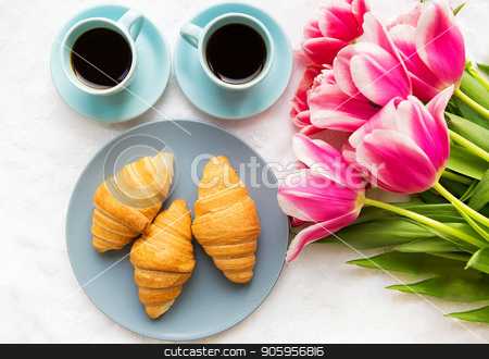 two cups of coffee, croissants and a bouquet of pink tulips, beautiful morning stock photo, two cups of coffee, croissants and a bouquet of pink tulips, beautiful morning. by Sergiy Artsaba