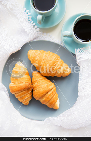 cup of coffee with croissant stock photo, two cups of coffee with croissants on the background laces by Sergiy Artsaba
