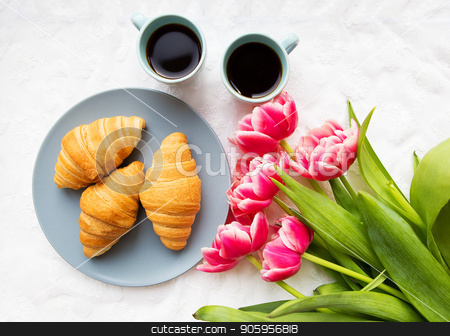 croissants on the background of laces with a bouquet of pink tulips, happy morning stock photo, croissants on the background of laces with a bouquet of pink tulips, happy morning. by Sergiy Artsaba
