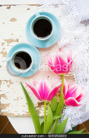 coffee, croissants and three beautiful pink tulips on old white table stock photo, coffee, croissants and three beautiful pink tulips on old white table. by Sergiy Artsaba