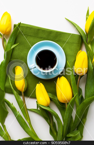 freshly brewed coffee stock photo, Yellow tulips with a cup of coffee on the white table with green cloth, close-up by Sergiy Artsaba
