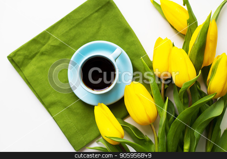 freshly brewed coffee stock photo, Yellow tulips with a cup of coffee on the white table with green cloth by Sergiy Artsaba