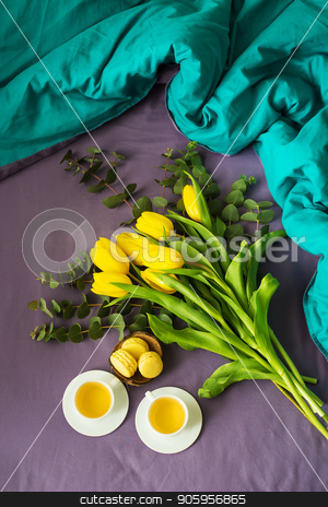 beautiful yellow tulips stock photo, yellow tulips, cookies and two cups of tea in bed, close-up by Sergiy Artsaba