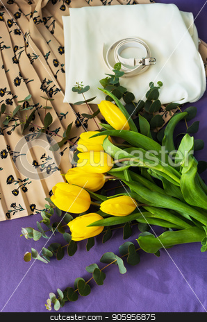 beautiful yellow tulips stock photo, Beautiful yellow tulips in a bed on the background of spring clothes, close-up by Sergiy Artsaba