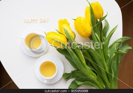 beautiful yellow tulips stock photo, Beautiful yellow tulips on the table, the inscription happy day by Sergiy Artsaba