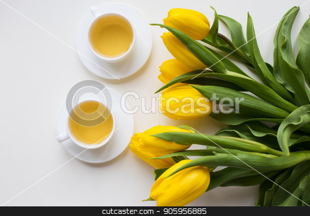 beautiful yellow tulips stock photo, beautiful yellow tulips, two cups of green tea, spring by Sergiy Artsaba