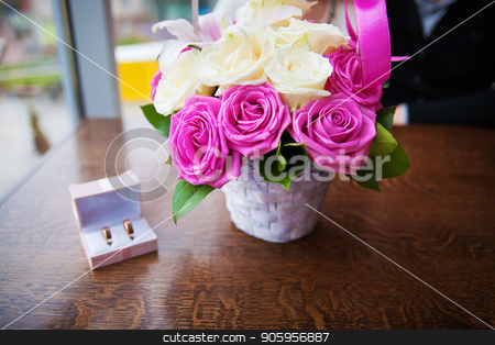 bouquet of beautiful and colorful flowers and wedding rings in a box stock photo, bouquet of beautiful and colorful flowers and wedding rings in a box. by Sergiy Artsaba