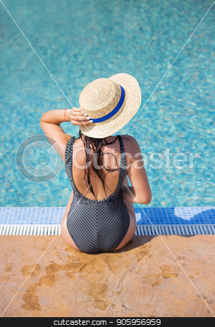 Beautiful girl in a black swimsuit near a blue pool-summer, sun, vacation stock photo, Beautiful girl in a black swimsuit near a blue pool-summer, sun, vacation. by Sergiy Artsaba