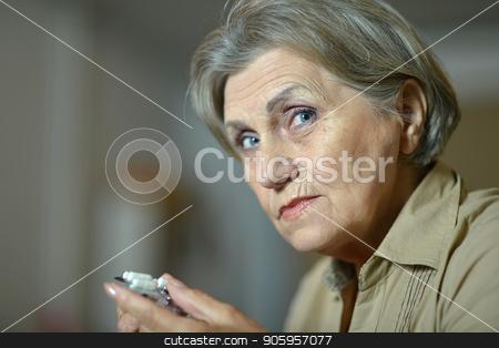 beautiful Sad senior woman with pills stock photo, beautiful sad senior woman with pills at home by Ruslan Huzau