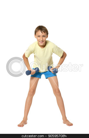 Young boy doing exercises stock photo, Young boy doing exercises with dumbbells isolated on white background by Ruslan Huzau