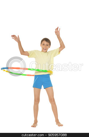 Young boy doing exercises stock photo, Young boy doing exercises with hoop isolated on white background by Ruslan Huzau